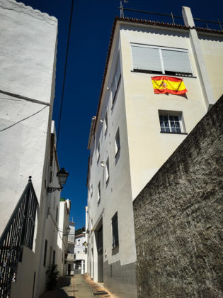 Spanish flag hanging from a bedroom window