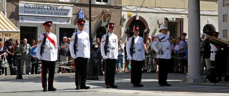5 guards standing to attention during the changing of the guards ceremony outside the Convent in Gibraltar