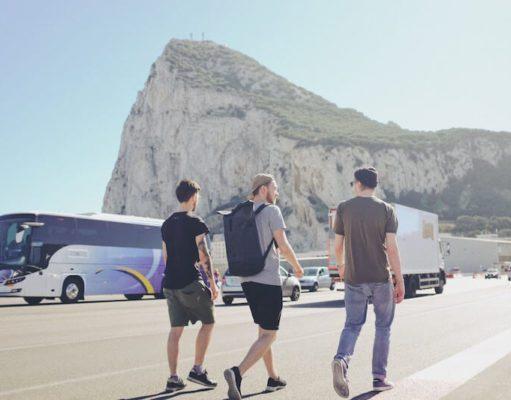 3 men walking across the main runway in Gibraltar