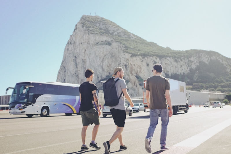 3 men walking across the main runway in Gibraltar