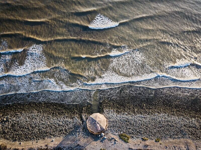 Waves breaking onto the beach taking from a drone