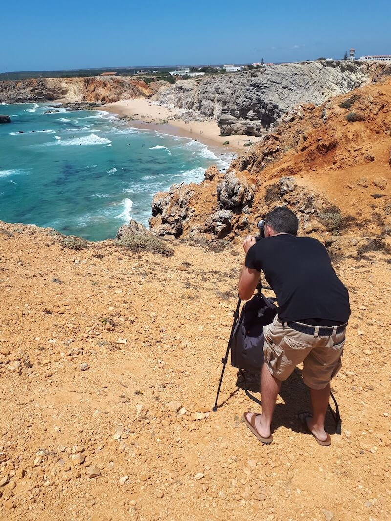 Me taking a photo of the coast in the Algarve, Portugal